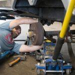 Man under axle